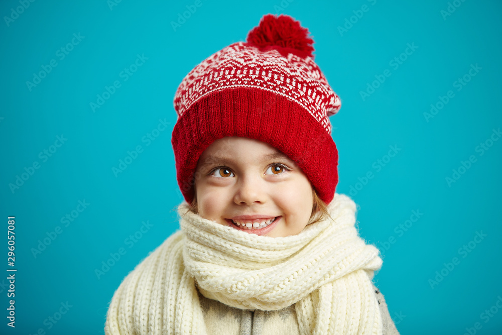 Fototapety, obrazy: portrait of beautiful little girl in red winter hat on blue background