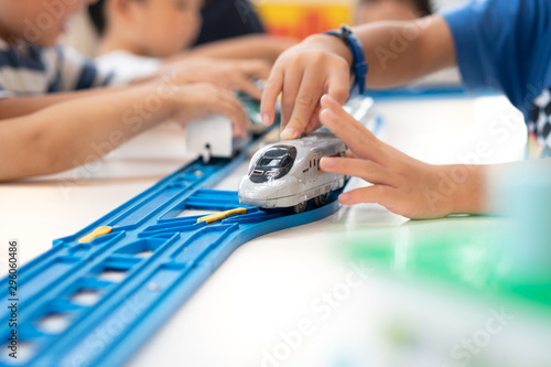 Close up of children hands playing, assembling the colorful plastic railway track Canvas-taulu