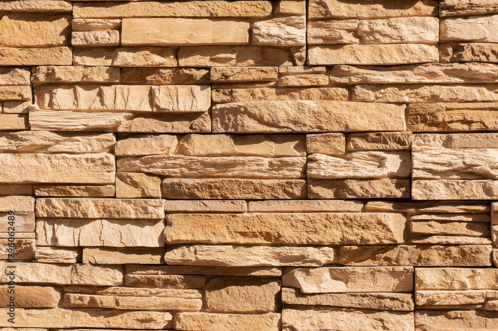 Tile stone wall pattern texture. For background or floor. Fragment of a wall from a chipped stone
