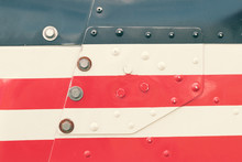 Colorful Background Of Metal Texture With Metal Patch. American Flag Colors. Vintage Aircraft Fragment