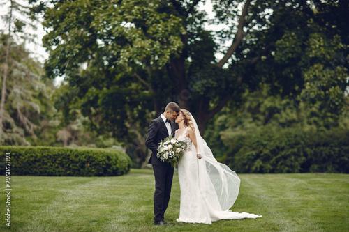 Fototapeta Beautiful bride in a long white dress
