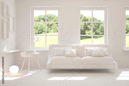 Foto auf AluDibond Rosa dunkel Stylish room in white color with sofa and summer landscape in window. Scandinavian interior design. 3D illustration