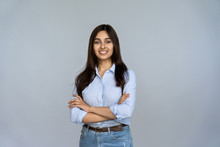 Smiling Indian Young Woman Sales Professional Arms Crossed Looking At Camera Isolated On Grey Blank Studio Background Copy Space, Happy Female Student Saleswoman Girl Posing On Gray Wall, Portrait