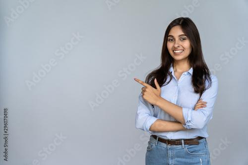 Valokuvatapetti Confident smiling indian young woman professional student customer saleswoman lo