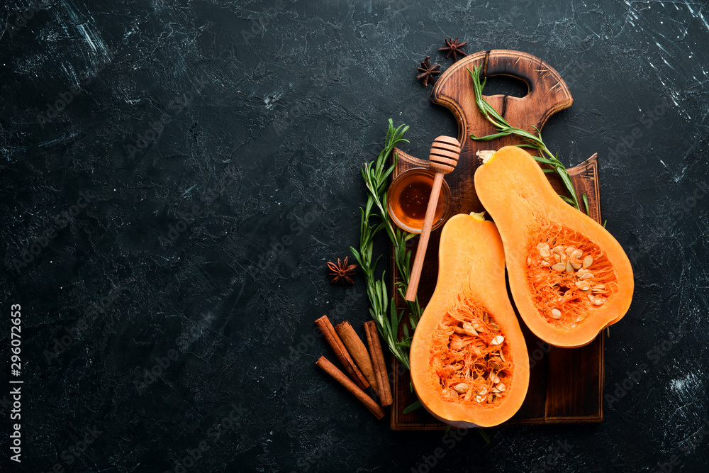 Fototapety, obrazy: Fresh pumpkin with honey, healthy food. On a black stone background. Top view. Free copy space.