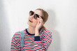 Leinwanddruck Bild - Close up pretty blond girl with sunglasses by white background