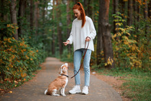 Beautiful Young Woman With Playful Young Dog Having Fun Outdoors, Full Length Photo. Lifestyle, Pastime, Leisure