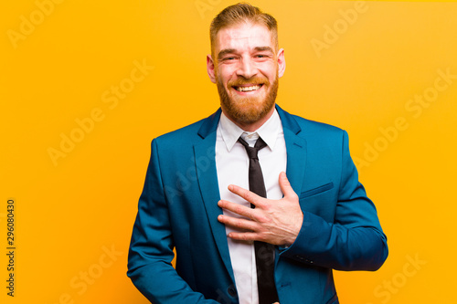 young red head businessman laughing out loud at some hilarious joke, feeling hap Canvas-taulu