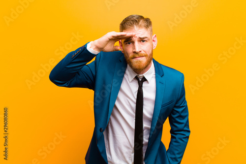 young red head businessman looking bewildered and astonished, with hand over for Canvas Print