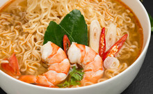 Instant Noodles, Tom Yum Kung Flavor Spicy, Spicy Flavor With Thailand Spices Placed On The Table, Black Background - Top View