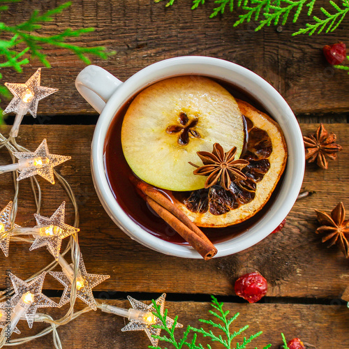 obraz lub plakat mulled wine, fragrant drink and festive mood atmosphere - concept New Year, Christmas. food background. copy space
