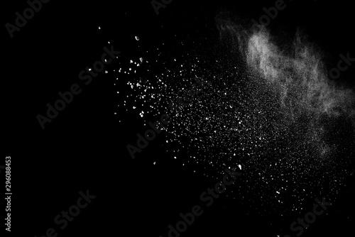 Fotografía White powder explosion on black background.