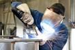 Leinwandbild Motiv welder works in metal construction - construction and processing of steel components