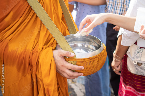 Photo The monks of the Buddhist Sangha(give alms to a Buddhist monk), which came out of the Buddhist offerings in the morning