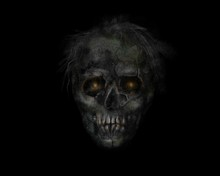 Scary Zombie Head On Black Background. Dead Man With Burning Yellow Eyes