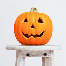 Close Up Of Pumpkin Head On Chair Over White