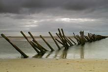 Old Skewed Wooden Breakwater T...