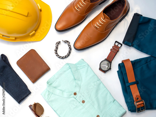 Men fashion casual clothing set isolated on white background include yellow shoes, green shirt, blue pants, wallet, safety helmet Obraz na płótnie