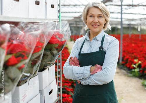Fotografiet  Confident female in her greenhouse
