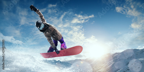 Snowboarder in action. Extreme winter sports. - 296125000