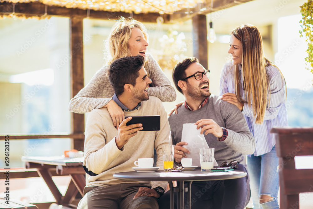 Fototapety, obrazy: Group of friends in cafe, using digital devices