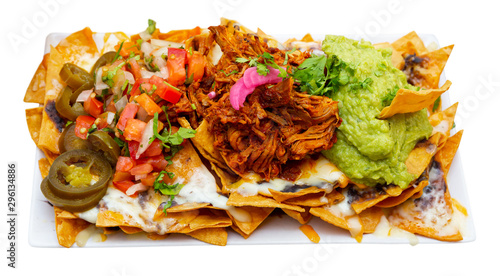Fotomural  Corn chips nachos with homemade guacamole sauce, meat, cheese
