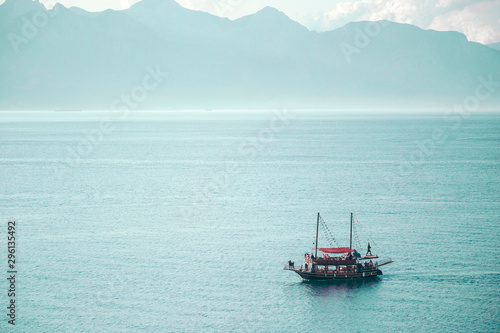 Foto op Plexiglas Schip Boat with passengers. Boat trips and excursions concept. Mountains on the background.