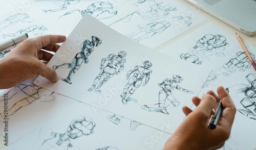 Fotografía  Animator designer Development designing drawing sketching development creating graphic pose characters sci-fi robot Cartoon illustration animation video game film production , animation design studio
