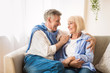 canvas print picture - Excited senior couple talking and relaxing at home