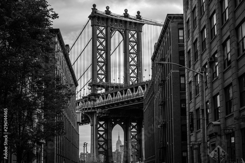 Photo  View of one of the towers of the Manhattan Bridge from the streets of the DUMBO