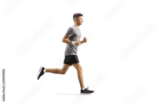 Young guy jogging Fototapete