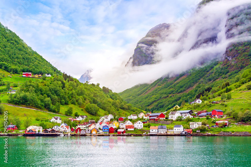 Wall Murals Northern Europe Beautiful idyllic landscape of the fjord Naeroyfjord in Gudvangen, Norway. A small traditional Scandinavian village on the picturesque coast of the fjord between the mountains. Travel background