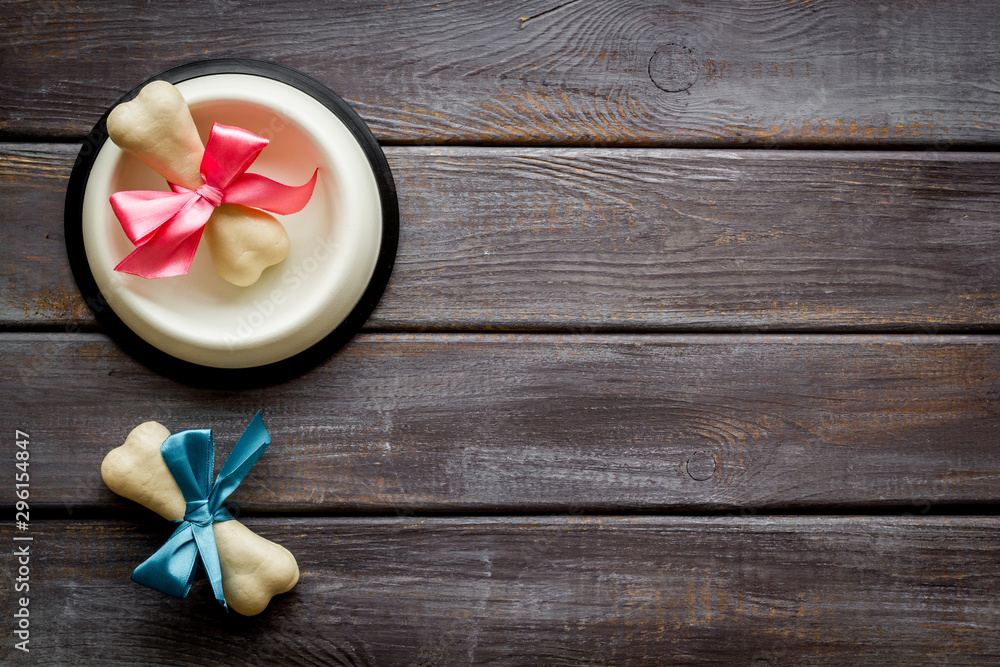 Fototapety, obrazy: Dog's birthday concept. Chewing bones with bow in bowl on dark wooden background top view space for text