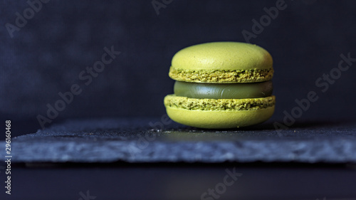 Fotobehang Macarons macaron on slate plate on a black background