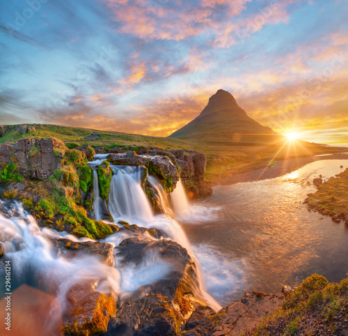 Beautiful landscape with sunrise on Kirkjufellsfoss waterfall and Kirkjufell mountain, Iceland, Europe. - 296161214