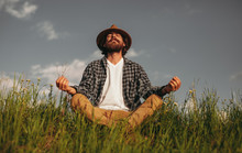 Bearded Male Meditating In Nat...