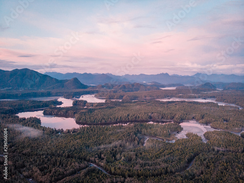Wall Murals Light pink Aerial view over Tofino Pacific Rim national park with drone from above Cox Bay Vancouver Island Canada