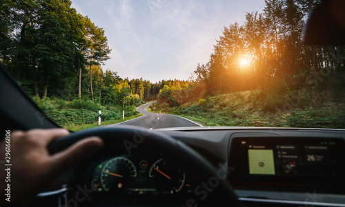 Valokuvatapetti hands of car driver on steering wheel, road trip, driving on highway road