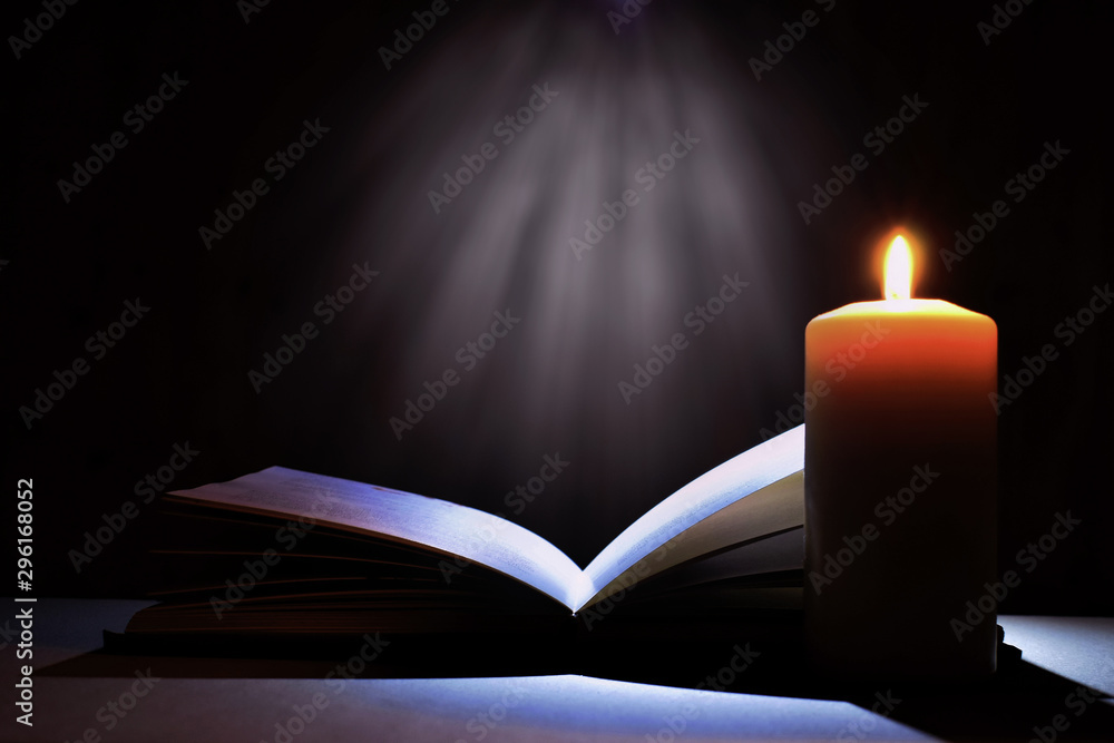 Fototapety, obrazy: Magic book and candle. Bible book and mysterious light.