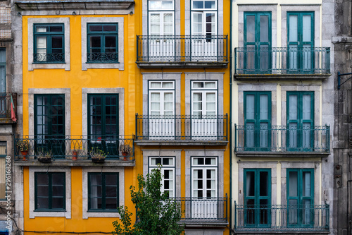 Fototapeta The facade of traditional building with beautiful windows at the Baixa neighborhood in the city of Porto, Portugal obraz
