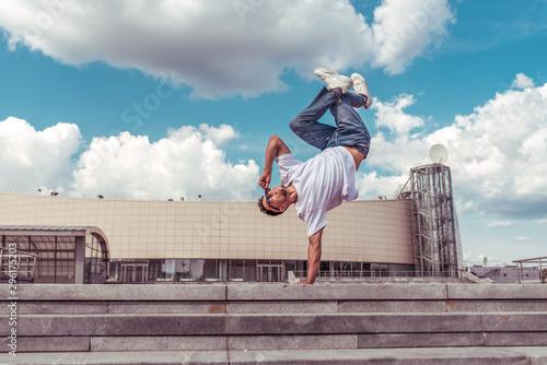 dancer on one arm dances break dance, hip-hop, artist acrobat Fototapeta