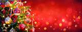 Fototapeta Sypialnia - Christmas Tree With Ornament And Bokeh Lights In Red Background