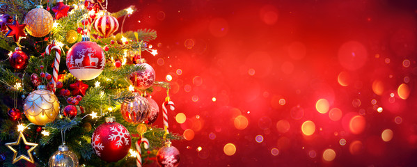 FototapetaChristmas Tree With Ornament And Bokeh Lights In Red Background