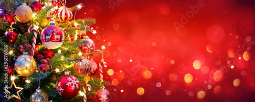 Obraz Christmas Tree With Ornament And Bokeh Lights In Red Background - fototapety do salonu