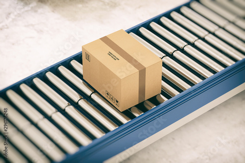 Cuadros en Lienzo Cardboard boxes on conveyor rollers ready to be shipped by courier for distribut