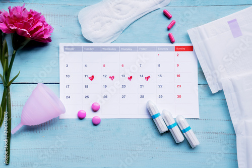 Calendar with feminine hygiene products on table Canvas Print