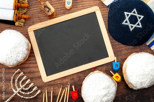 Obraz na plátně Happy Hanukkah and judaism conceptual idea with wood dreidel, traditional menora