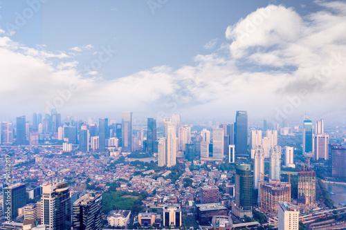 Aluminium Prints Blue Jakarta cityscape with air pollution smoke
