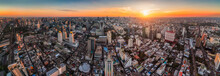 Wide Panoramic View Of Bangkok, Thailand. Cityscape With Skyscrapers At Sunset