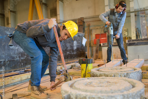 Fototapety, obrazy: mason workers making a cement form